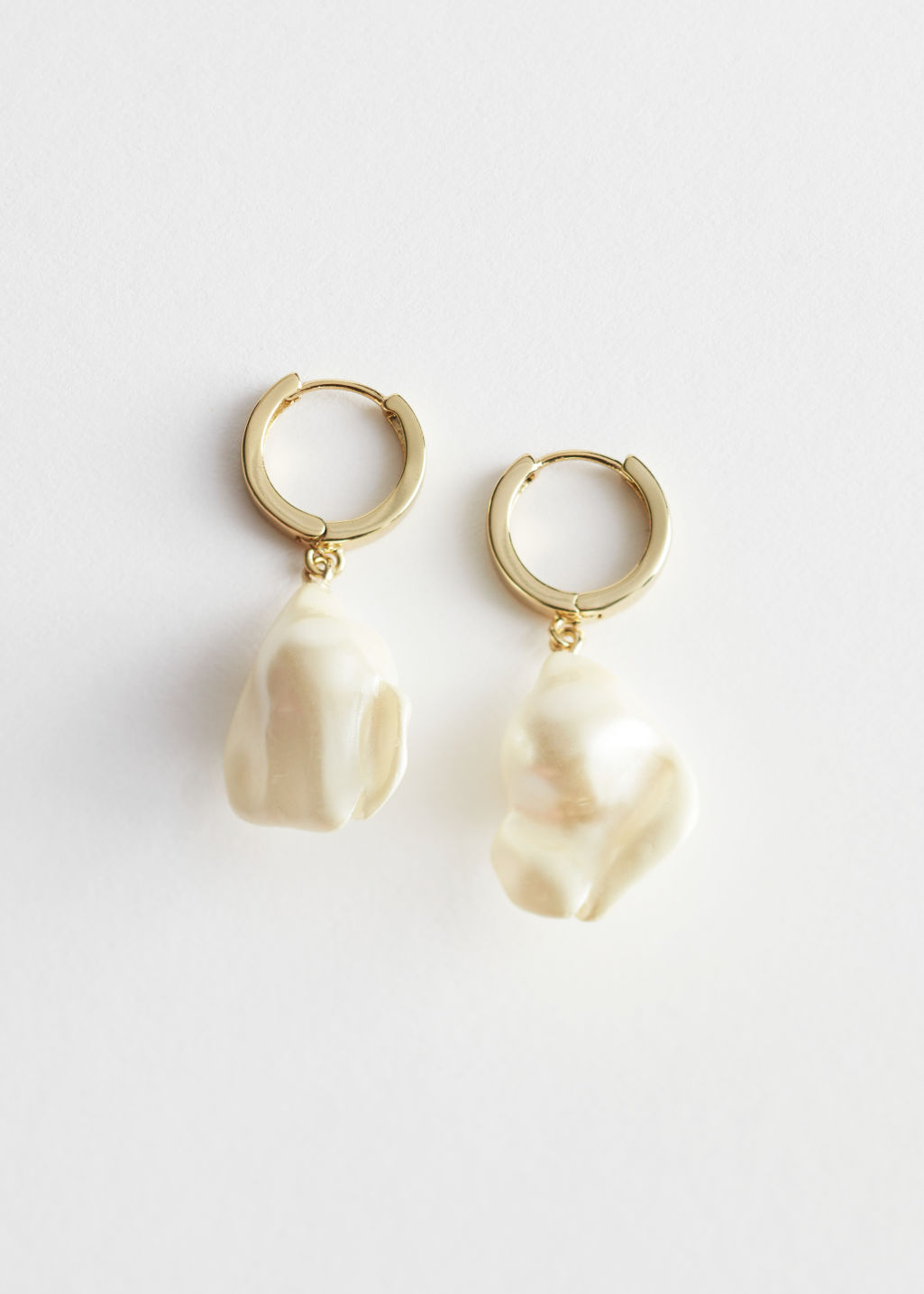 Front image of Stories hammered pearl pendant hoop earrings in white