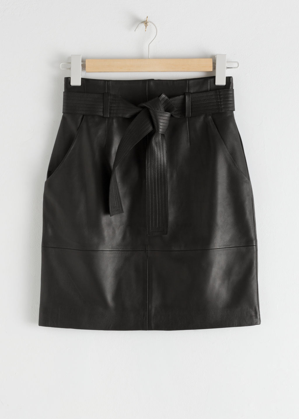 StillLife Front Image of Stories Leather High Waisted Belted Mini Skirt in Black