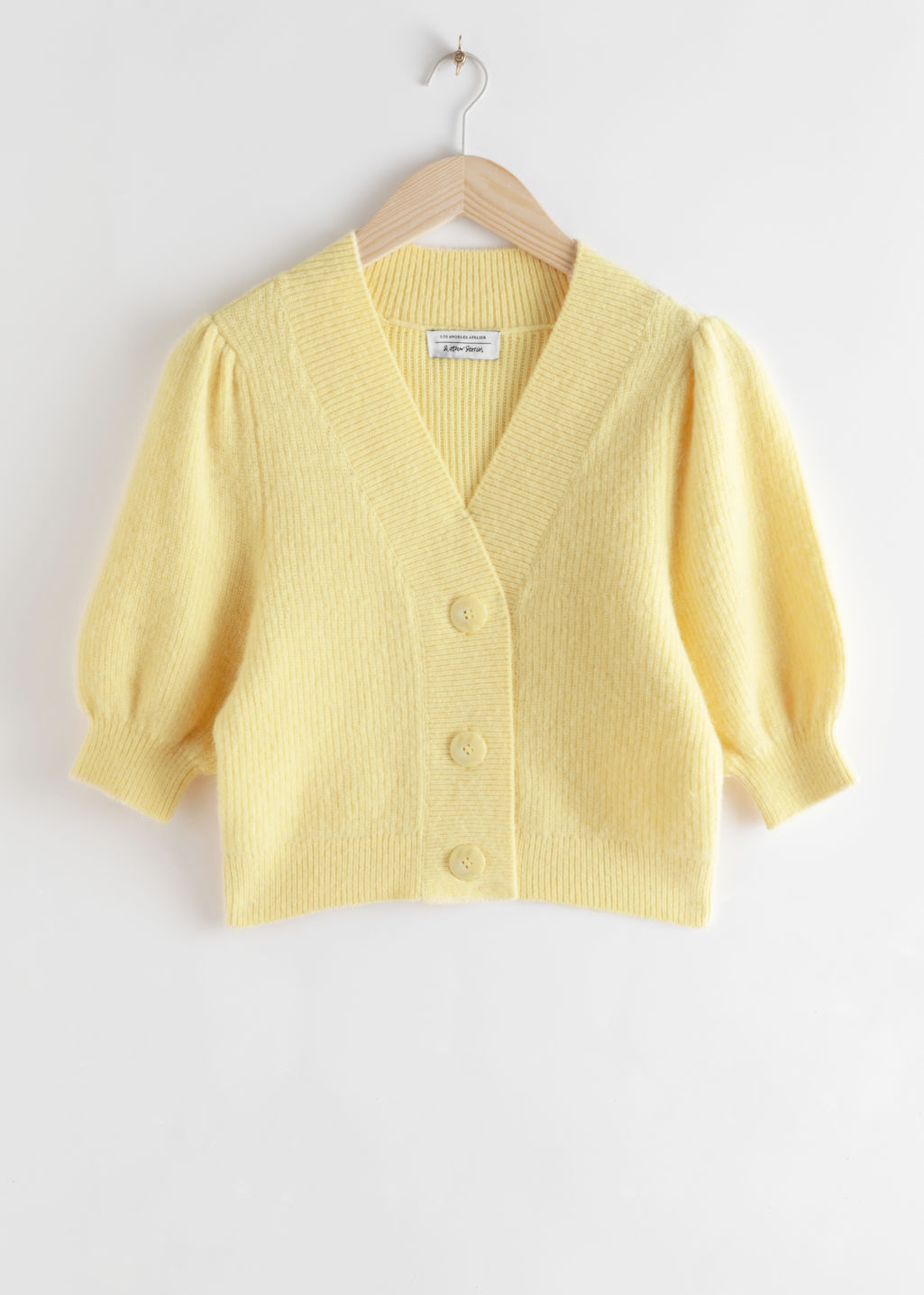 Front image of Stories puff sleeve wool blend cardigan in yellow