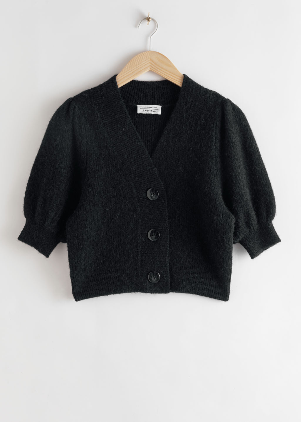Front image of Stories puff sleeve wool blend cardigan in black