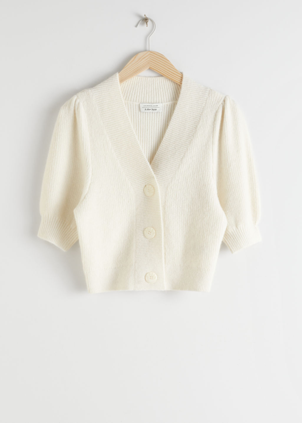 Front image of Stories puff sleeve wool blend cardigan in white