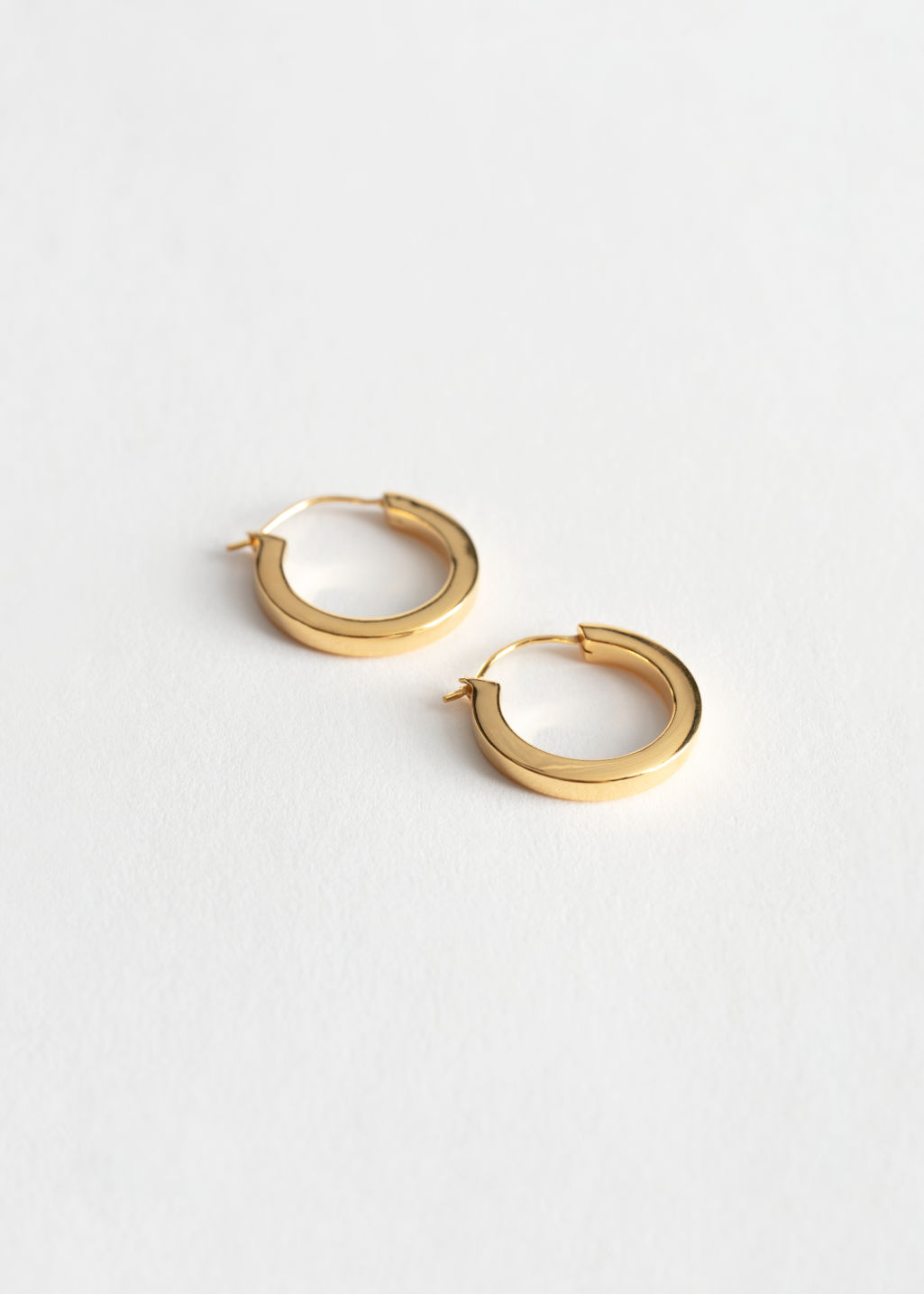 StillLife Front Image of Stories Sterling Silver Mini Hoop Earrings in Gold