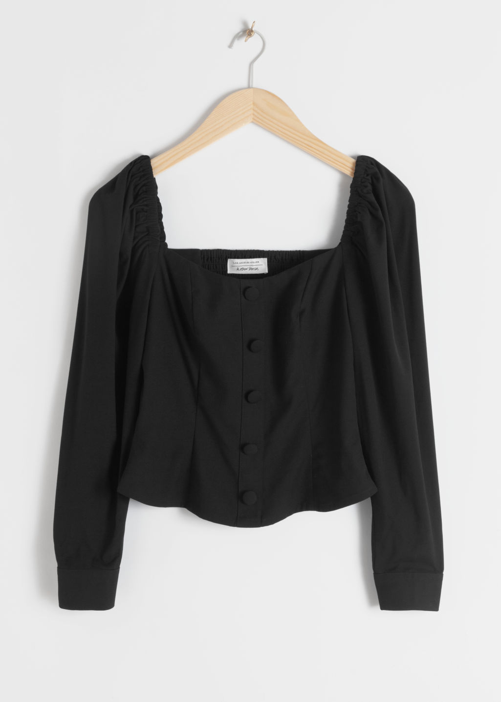 Front image of Stories square neck smocked blouse in black