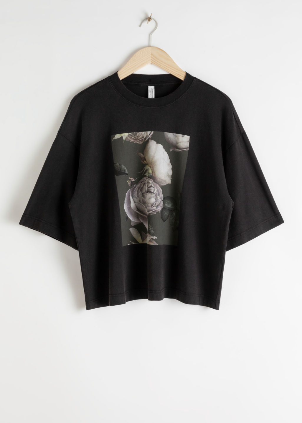 StillLife Front Image of Stories Oversized Rose Print T-Shirt in Black