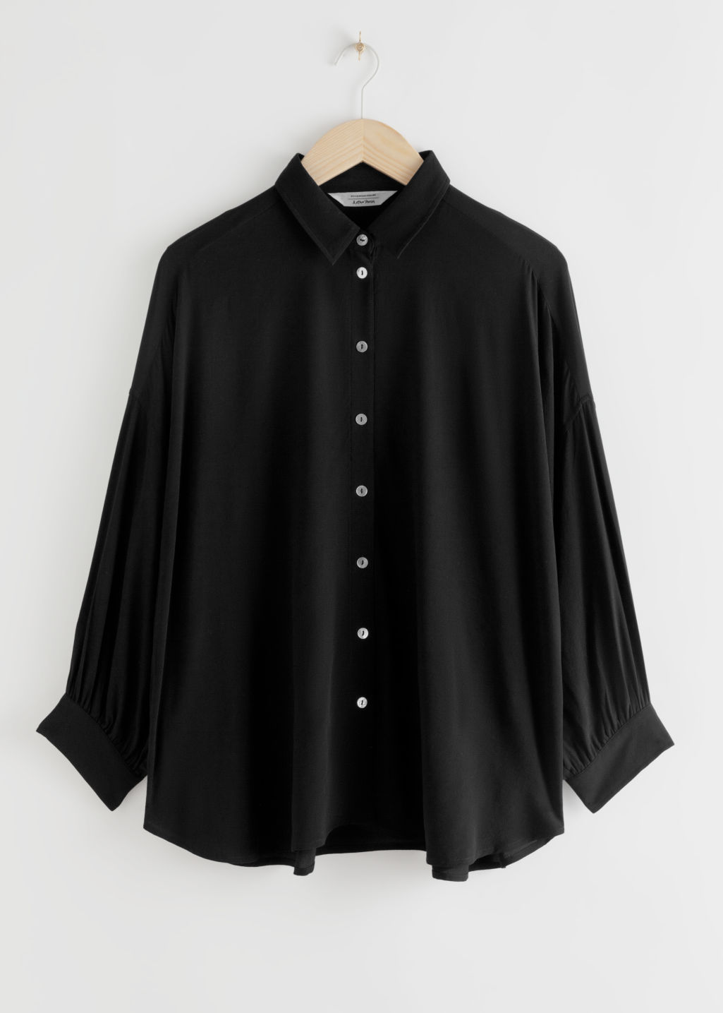 Front image of Stories flowy button up shirt in black