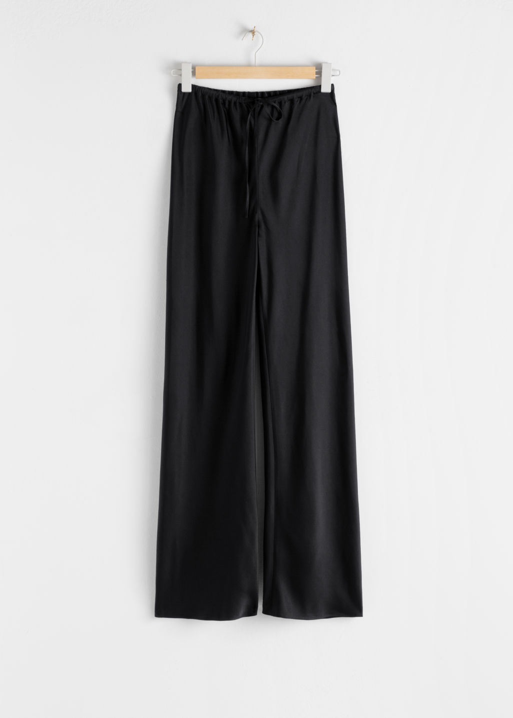 StillLife Front Image of Stories Slouchy Drawstring Trousers in Black