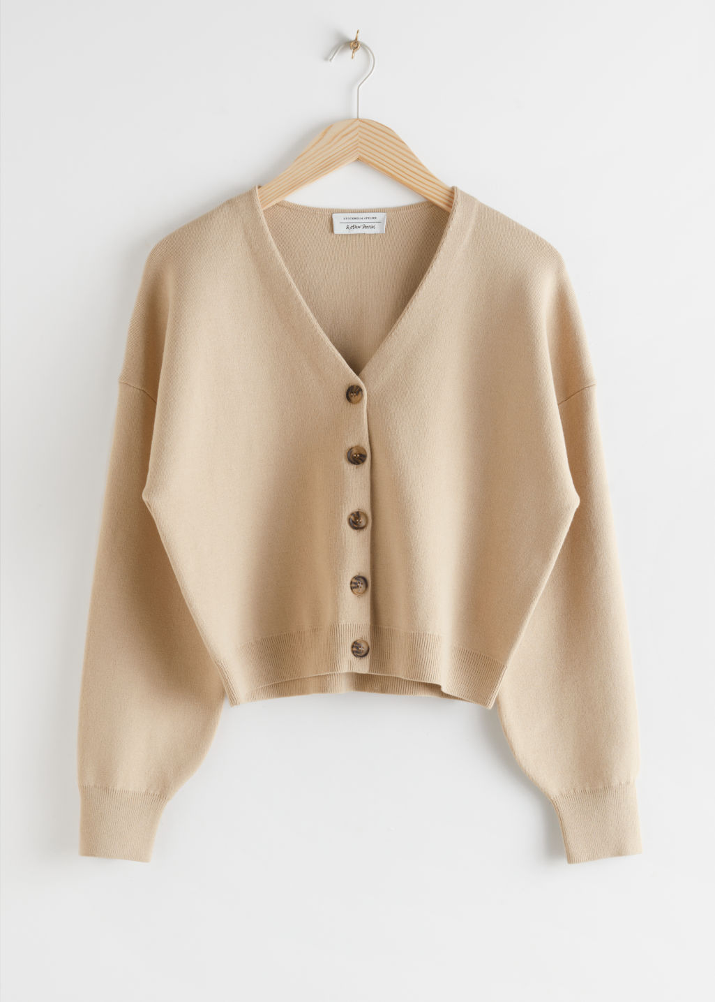 StillLife Front Image of Stories Boxy Plunging V-Cut Cardigan in Beige