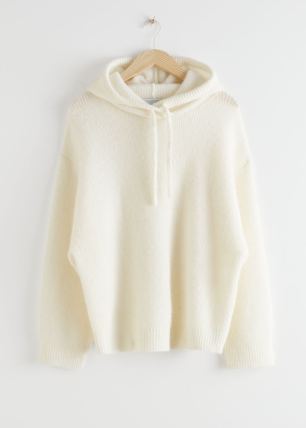 StillLife Front Image of Stories Ribbed Wool Blend Hooded Sweatshirt in White