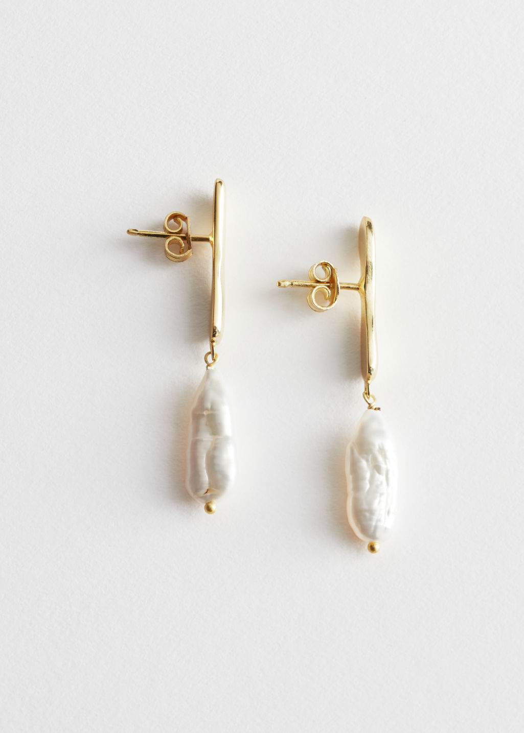 Front image of Stories small hammered pearl earrings in white