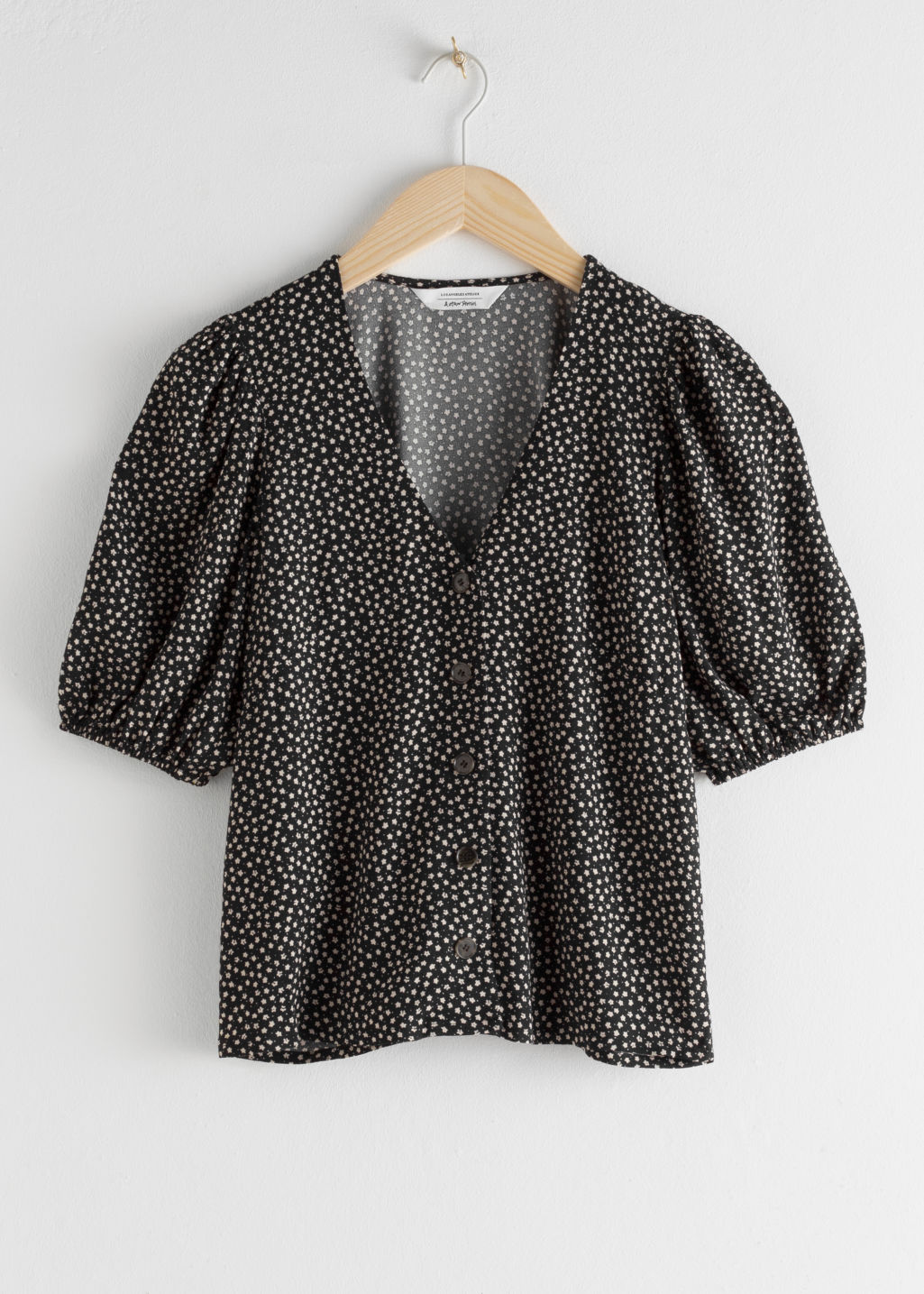 Front image of Stories puff sleeve button up blouse in black