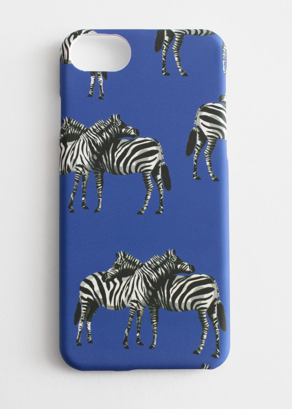 Front image of Stories zebra print iphone case in blue