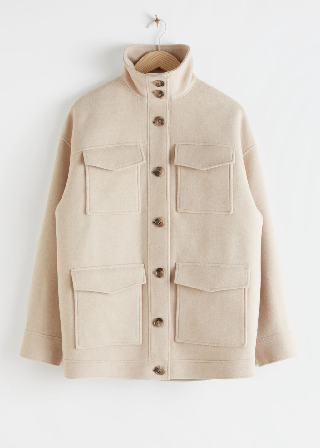 Front image of Stories oversized wool blend utility jacket in beige