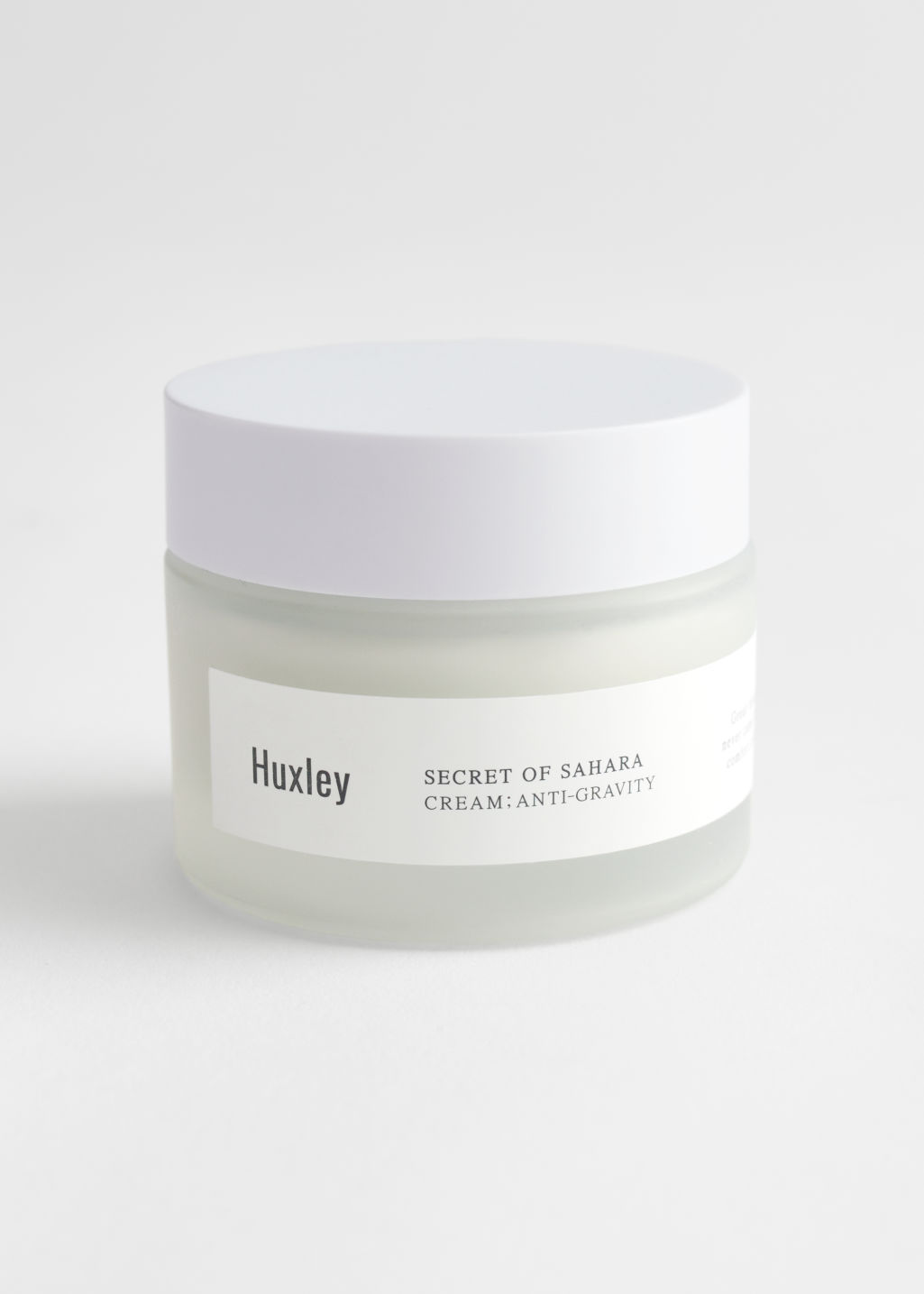 StillLife Front Image of Stories Huxley Anti-Gravity Cream in White