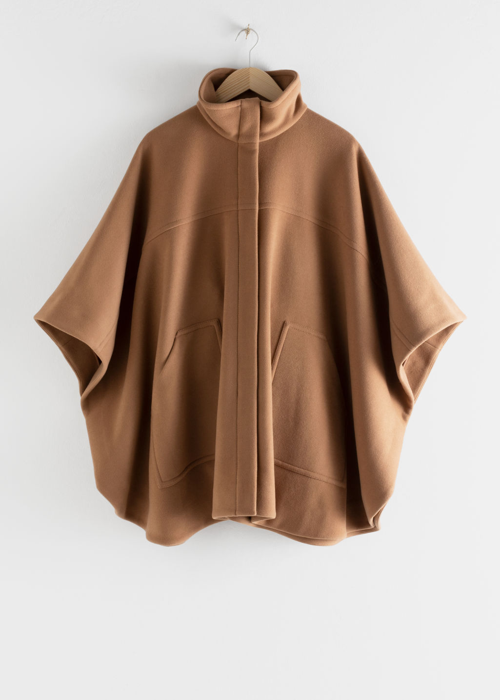 Front image of Stories voluminous wool blend cape in beige