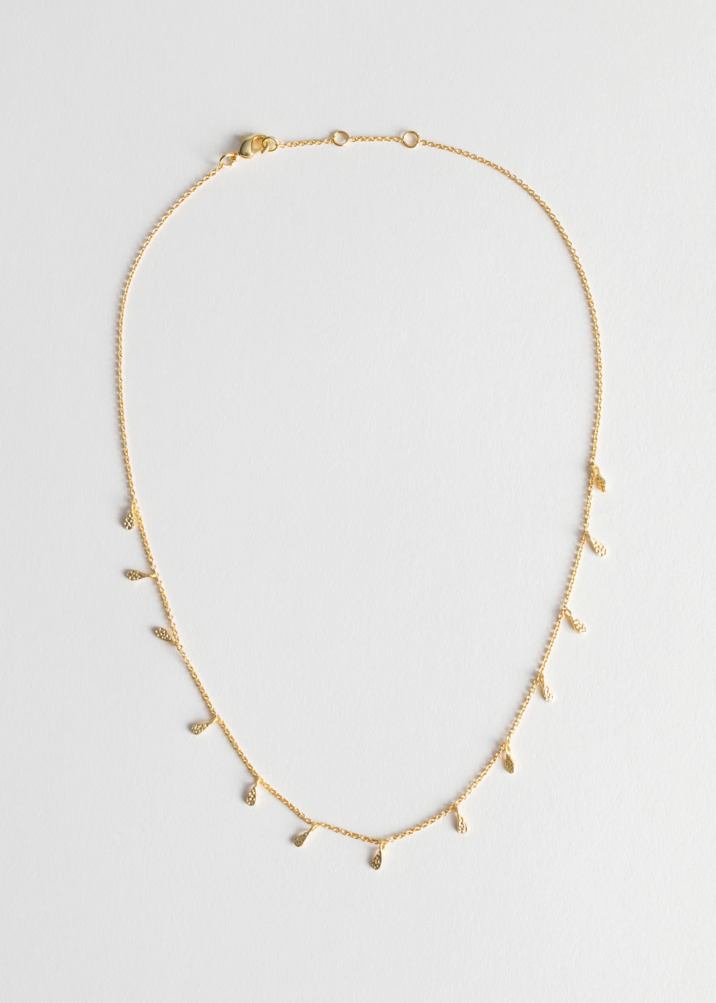 Front image of Stories droplet necklace in gold