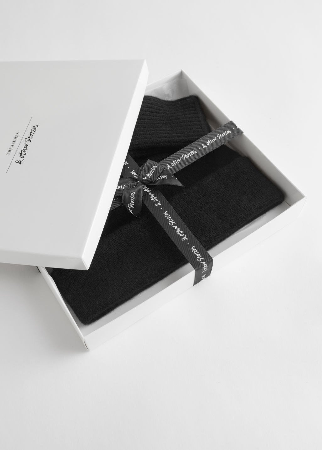 Front image of Stories cashmere beanie and gloves gift box in black