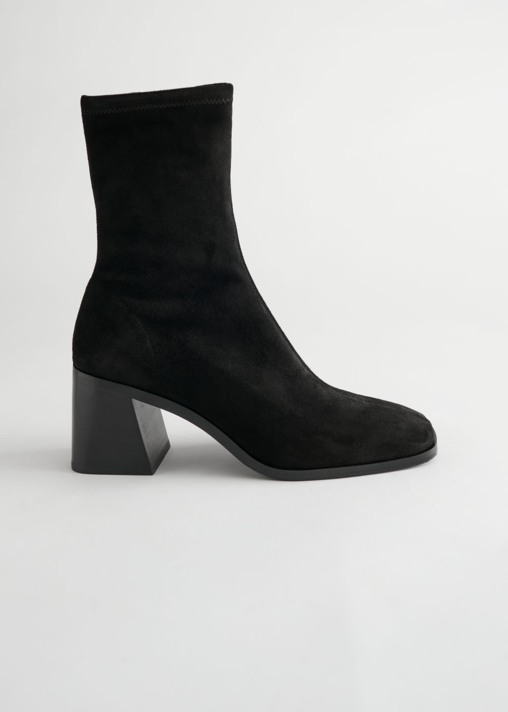 StillLife Side Image of Stories Geometric Heel Suede Sock Boots in Black