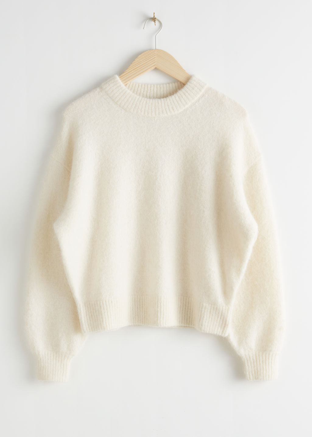 Front image of Stories fuzzy wool blend sweater in white