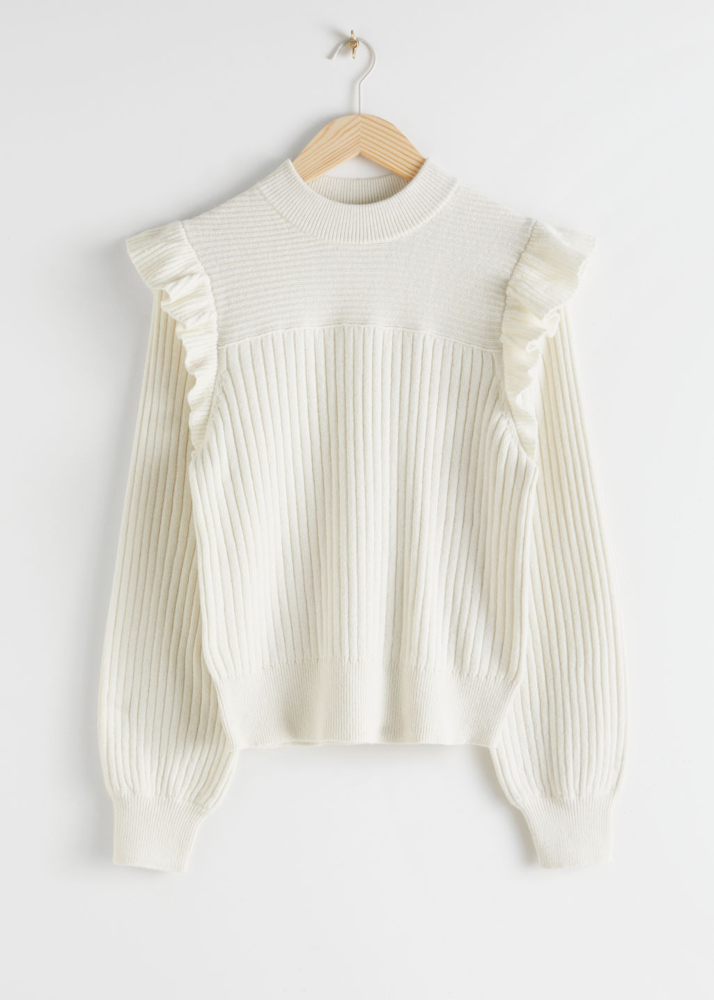 Front image of Stories frilled mock neck sweater in white