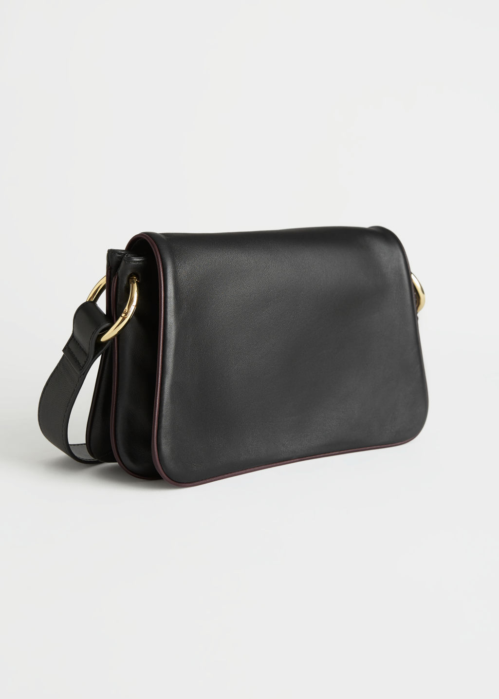 StillLife Front Image of Stories Small Leather Shoulder Bag in Black