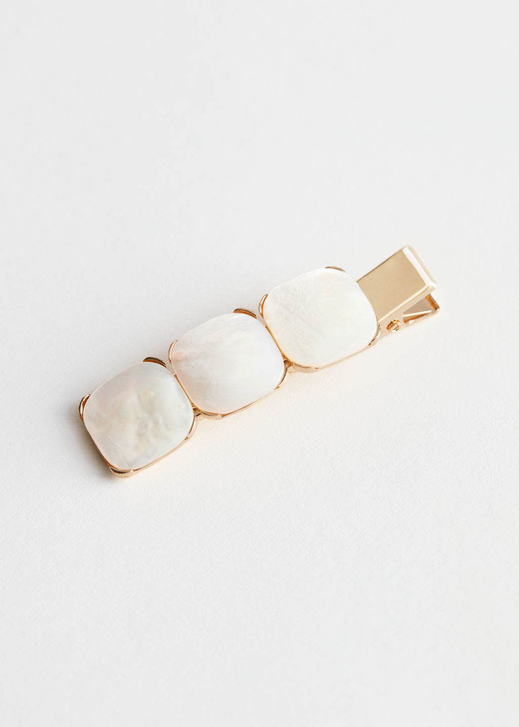 Front image of Stories iridescent square pendant hair clip in white