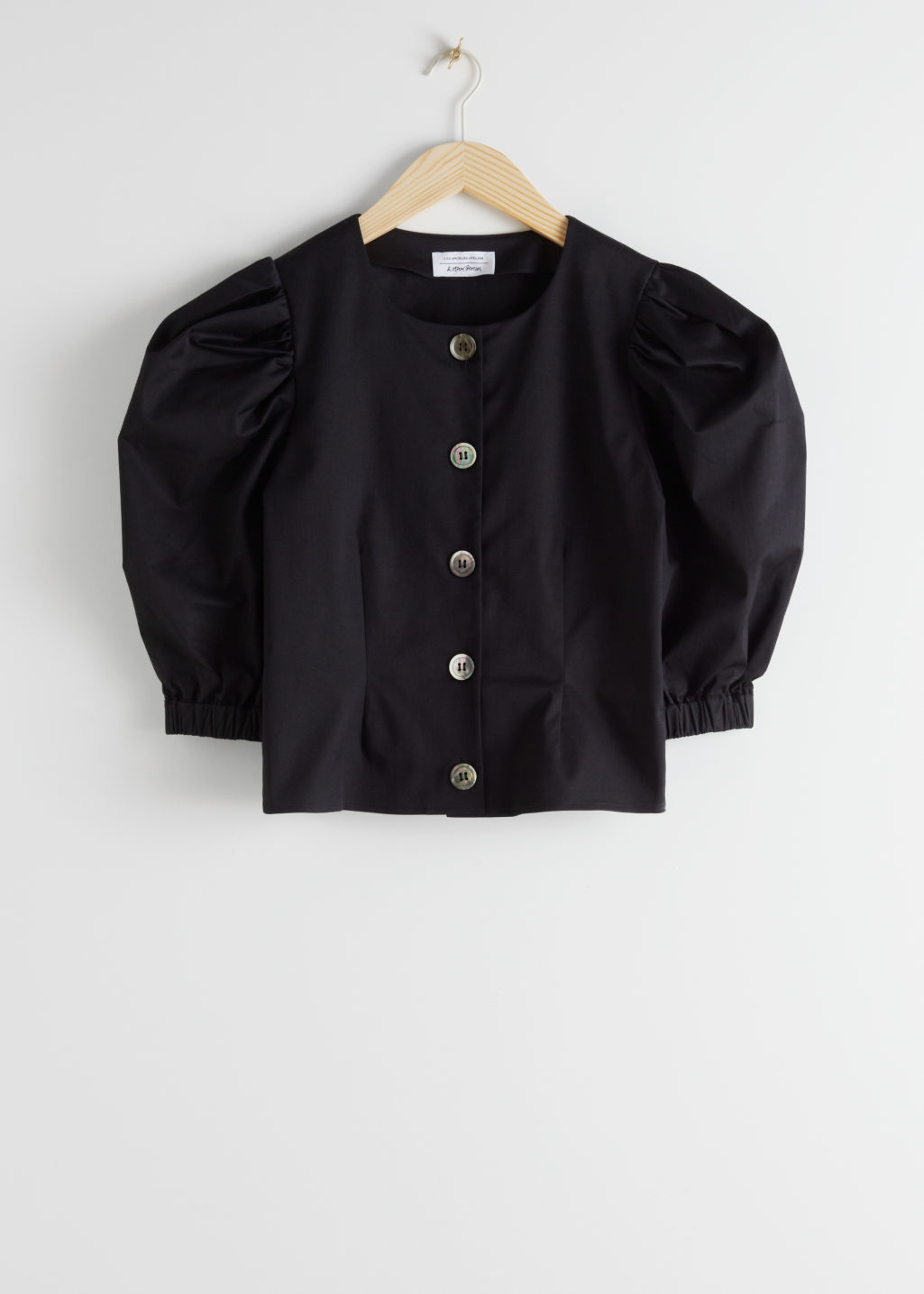 Front image of Stories organic cotton blend puff sleeve blouse in black