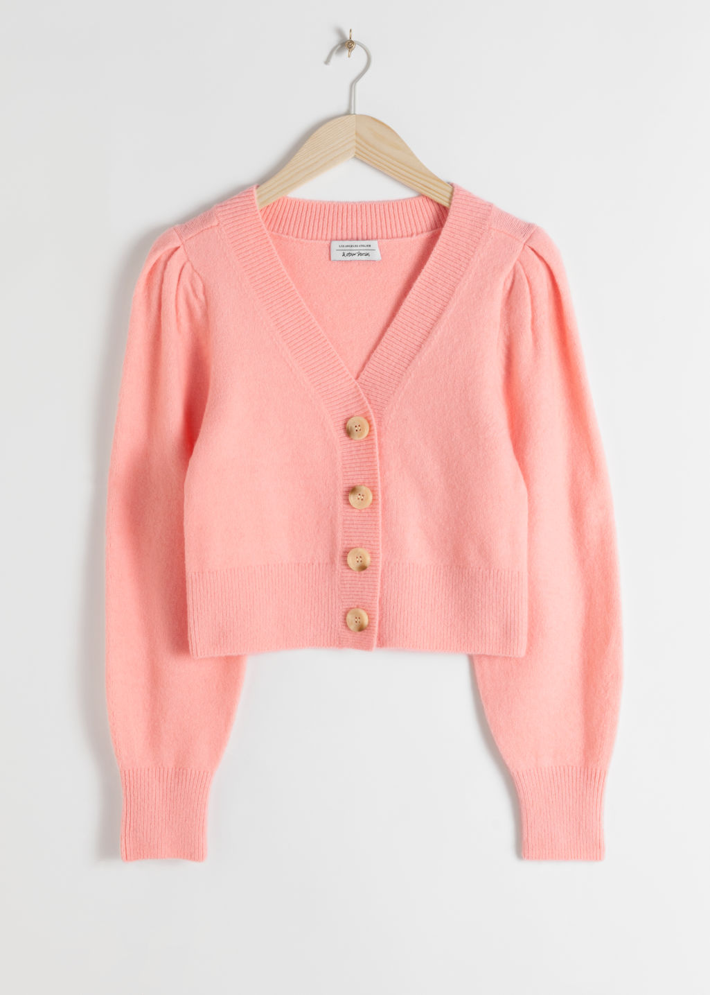 Front image of Stories puff sleeve short cardigan in pink