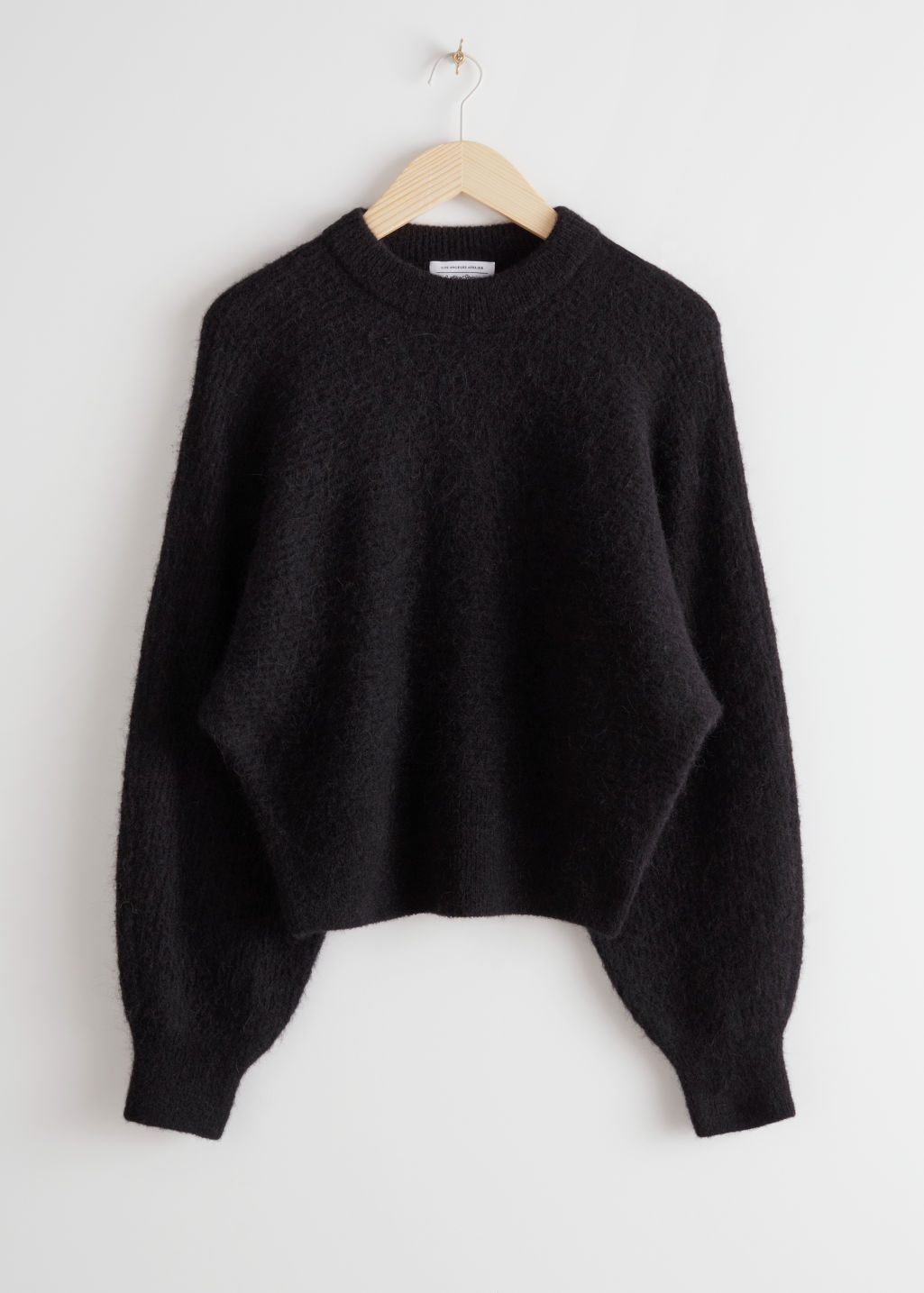 StillLife Front Image of Stories Mock Neck Alpaca Blend Sweater in Black