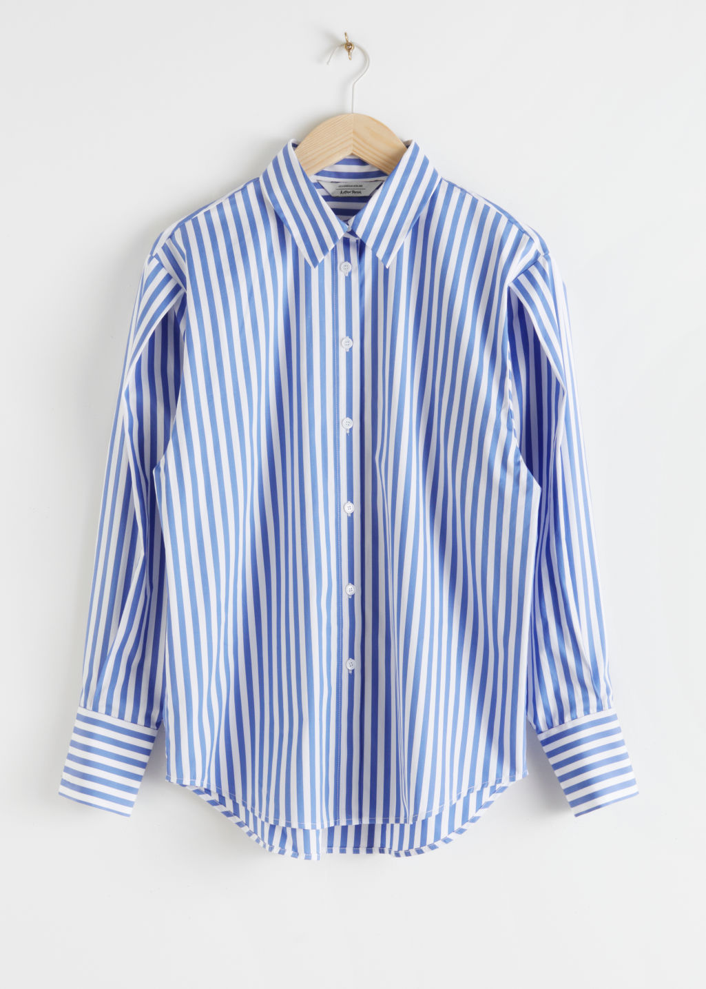 Front image of Stories striped relaxed fit shirt in white
