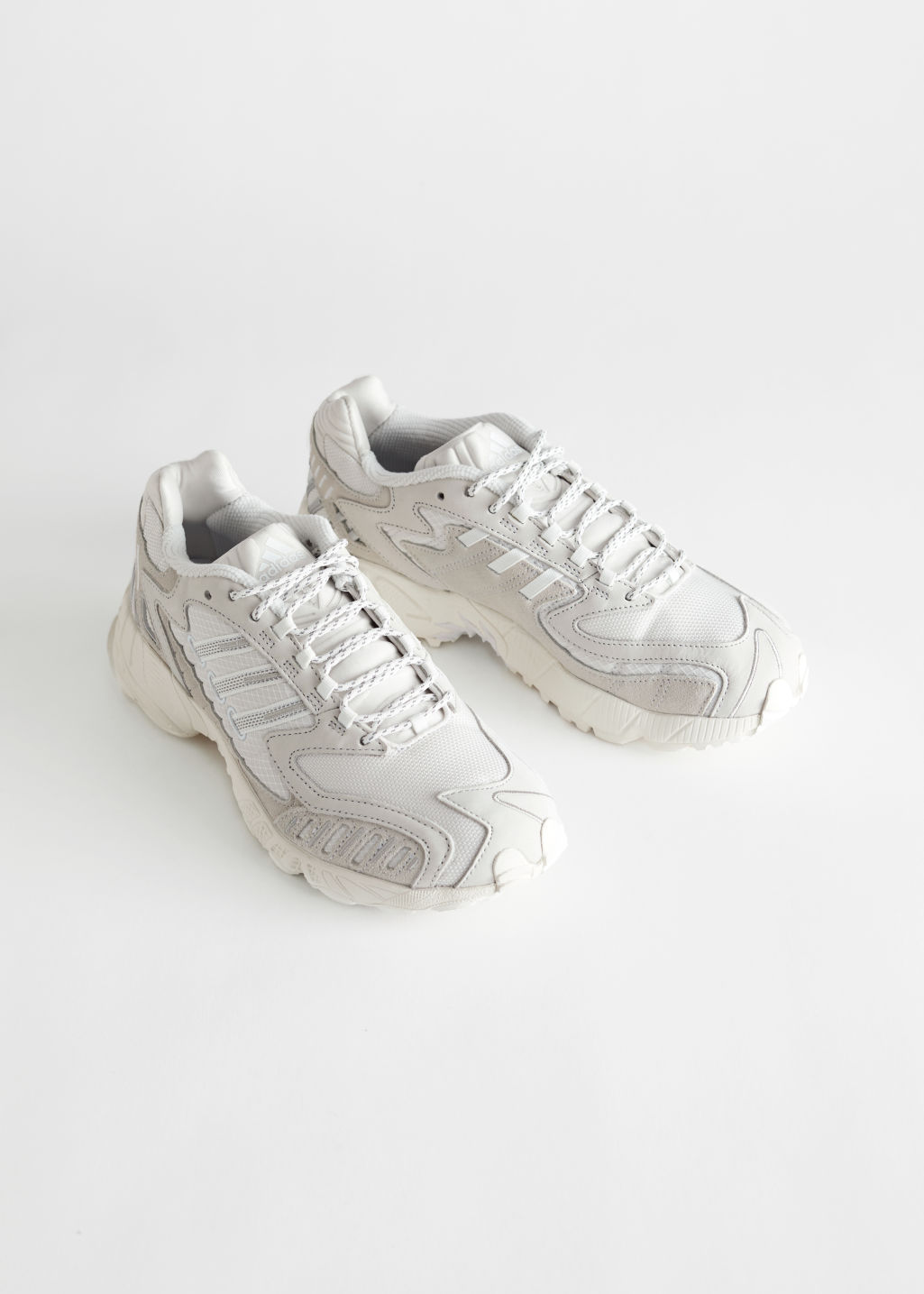 StillLife Front Image of Stories adidas Torsion TRDC in White