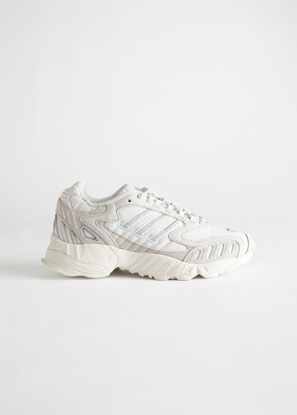 StillLife Side Image of Stories adidas Torsion TRDC in White