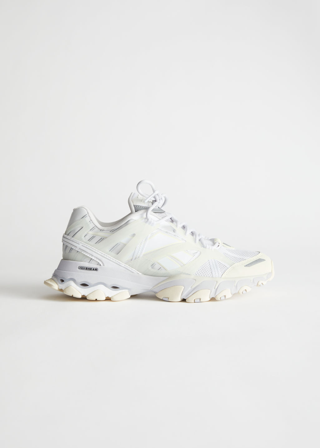 StillLife Side Image of Stories Reebok DMX Trail Shadow in White