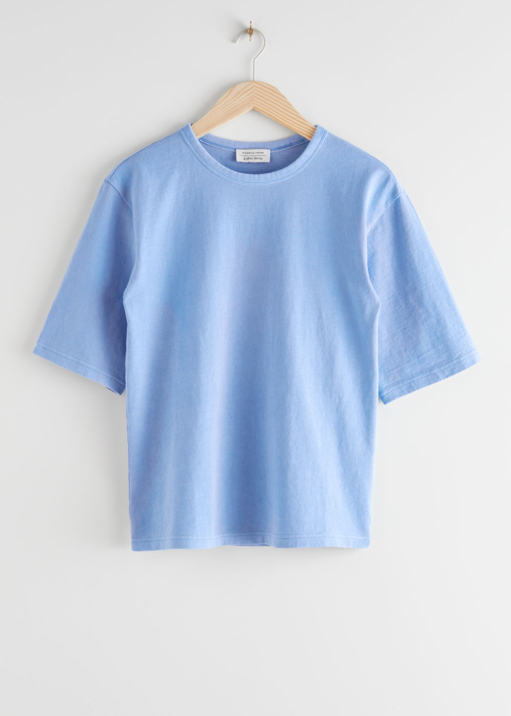 StillLife Front Image of Stories Loose Fit Organic Cotton T-Shirt in Blue