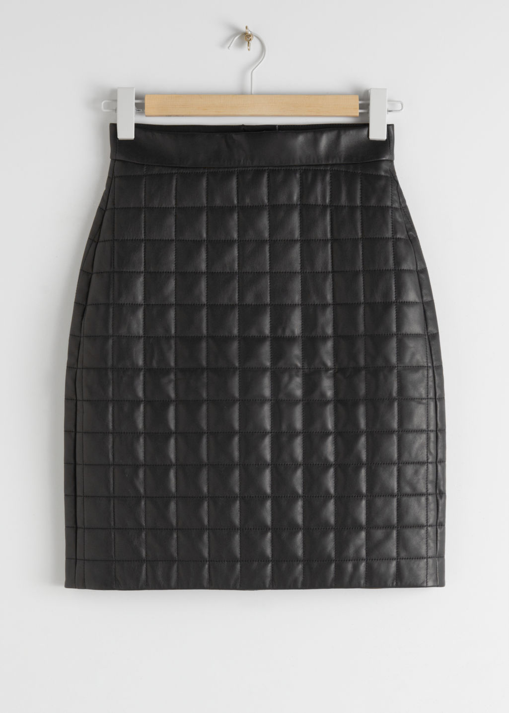 Front image of Stories quilted leather skirt in black