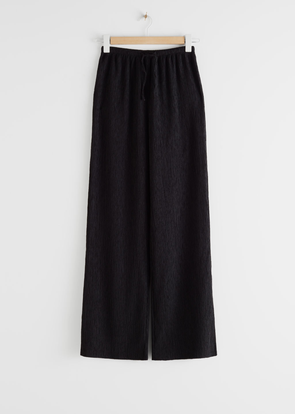 StillLife Front Image of Stories Lyocell Blend Drawstring Flared Trousers in Black