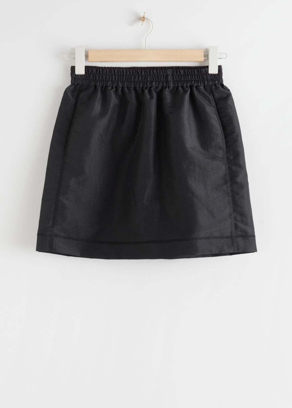 StillLife Front Image of Stories Technical Finish Mini Skirt in Black
