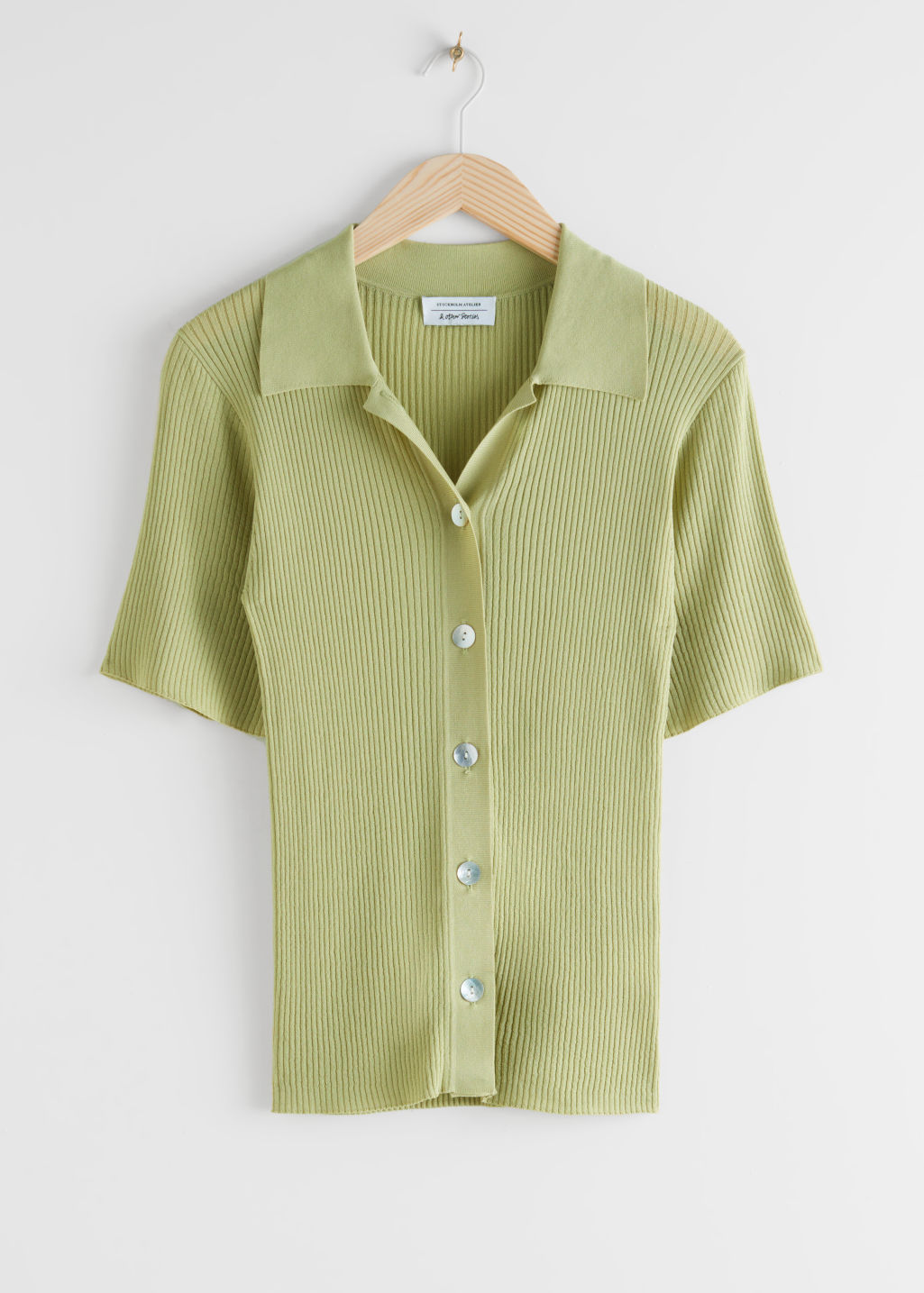 Front image of Stories fitted button up ribbed shirt in green