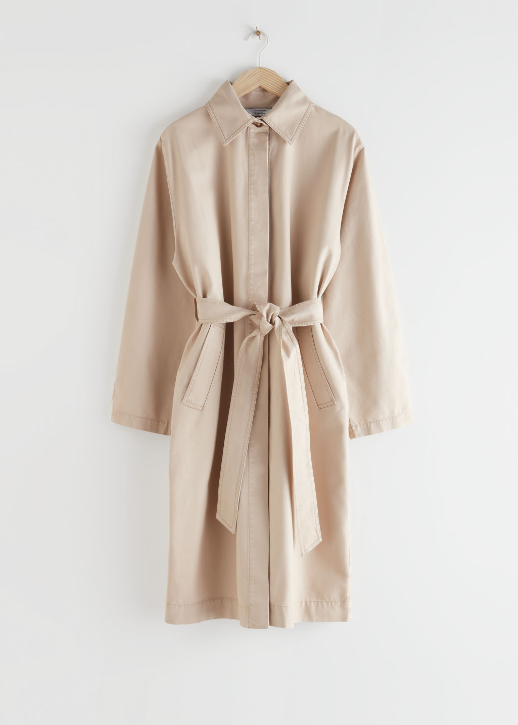 StillLife Front Image of Stories Belted Canvas Coat in Beige