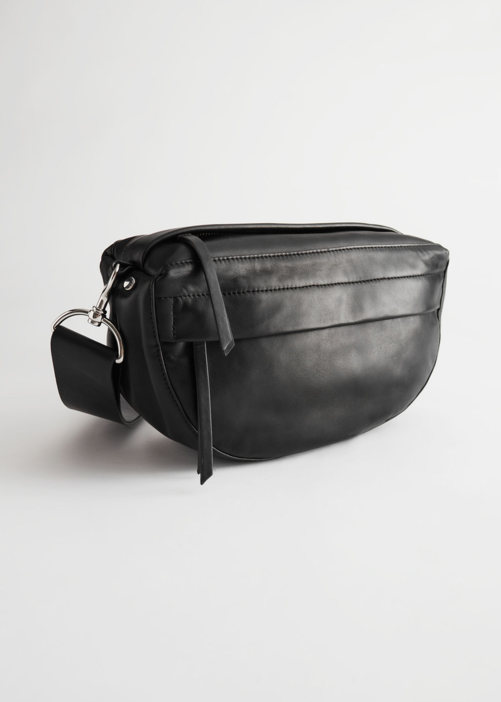 StillLife Front Image of Stories Leather Half Moon Crossbody Bag in Black