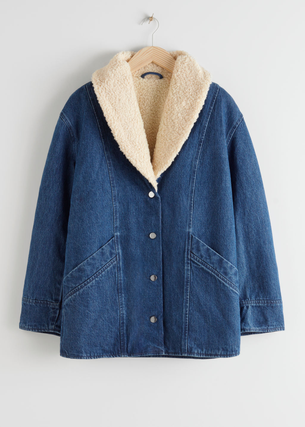 StillLife Front Image of Stories Organic Cotton Shearling Collar Denim Coat in Blue