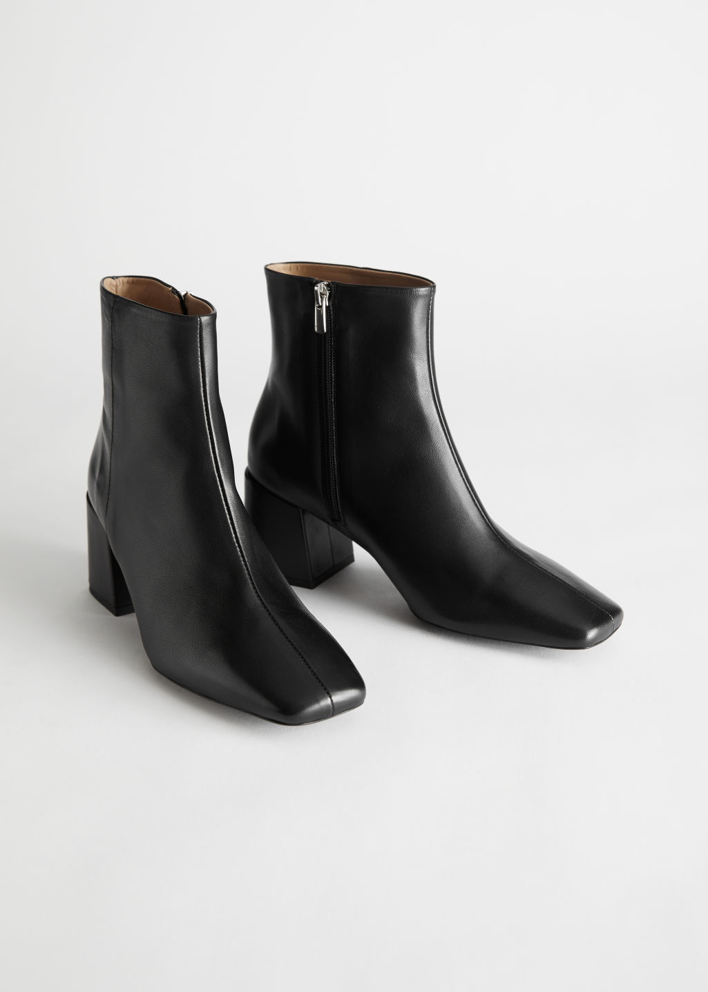 StillLife Front Image of Stories Leather Square Toe Heeled Boots in Black
