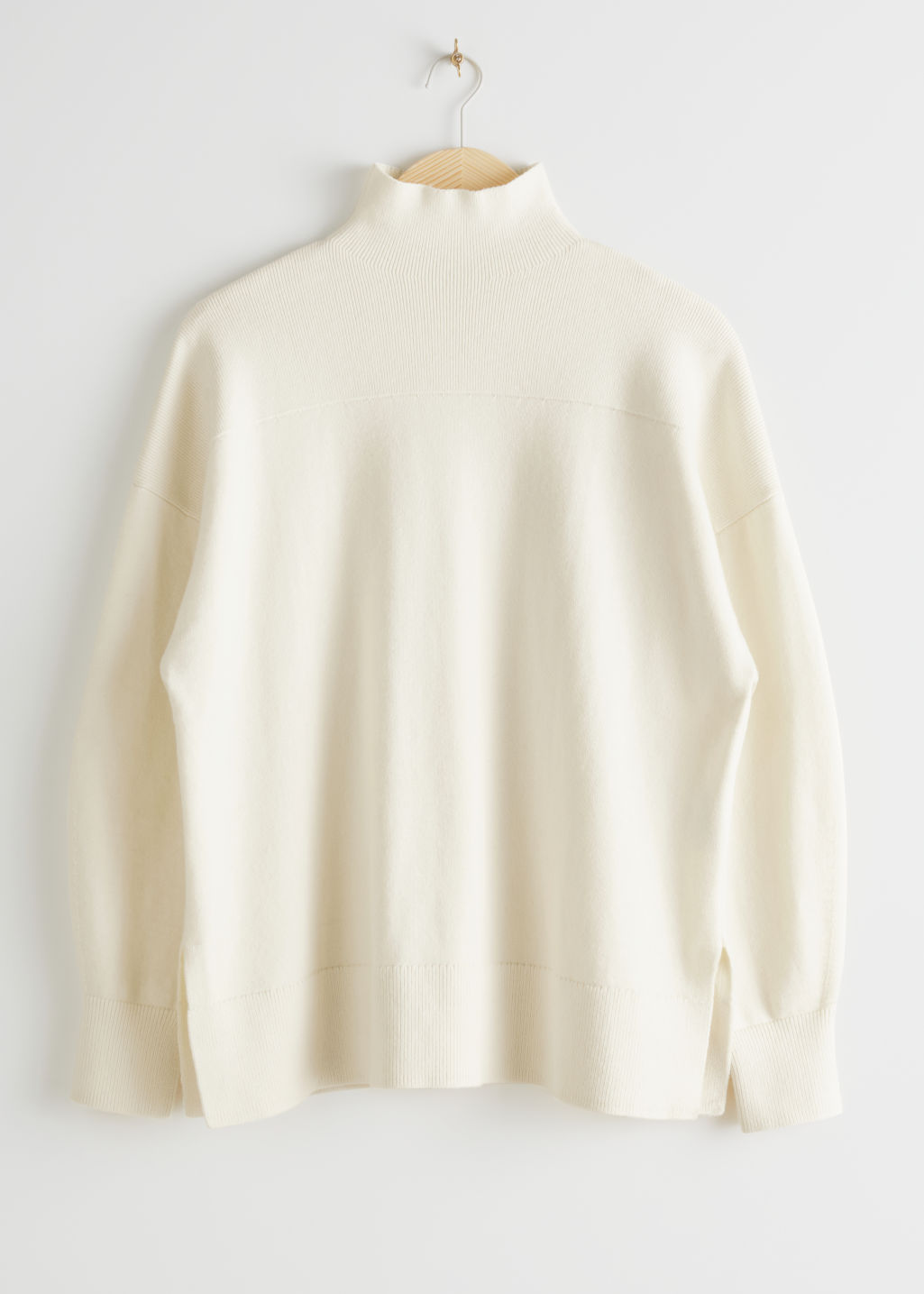 Front image of Stories relaxed turtleneck rib knit sweater in white