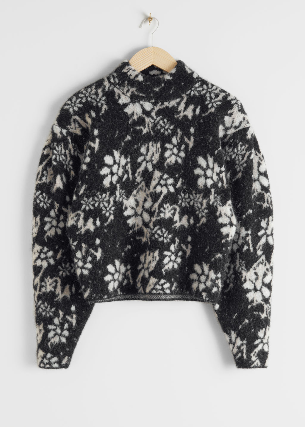 StillLife Front Image of Stories Alpaca Blend Mock Neck Jacquard Sweater in Black