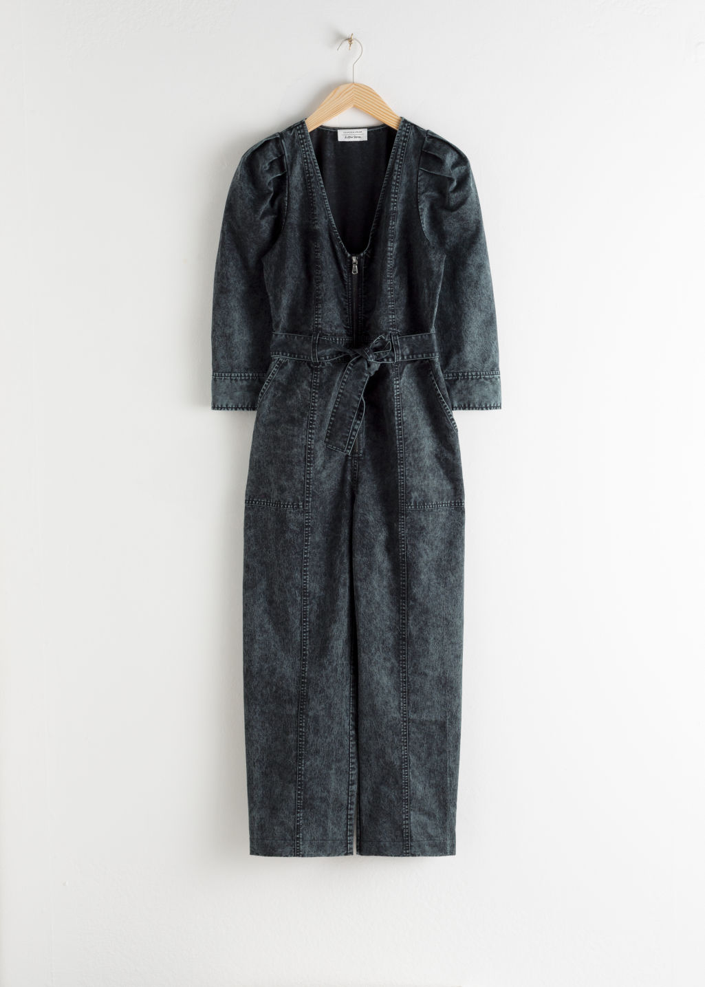 Front image of Stories stonewash denim puff sleeve jumpsuit in black