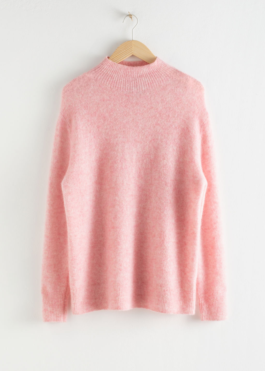 Front image of Stories relaxed mock neck sweater in pink