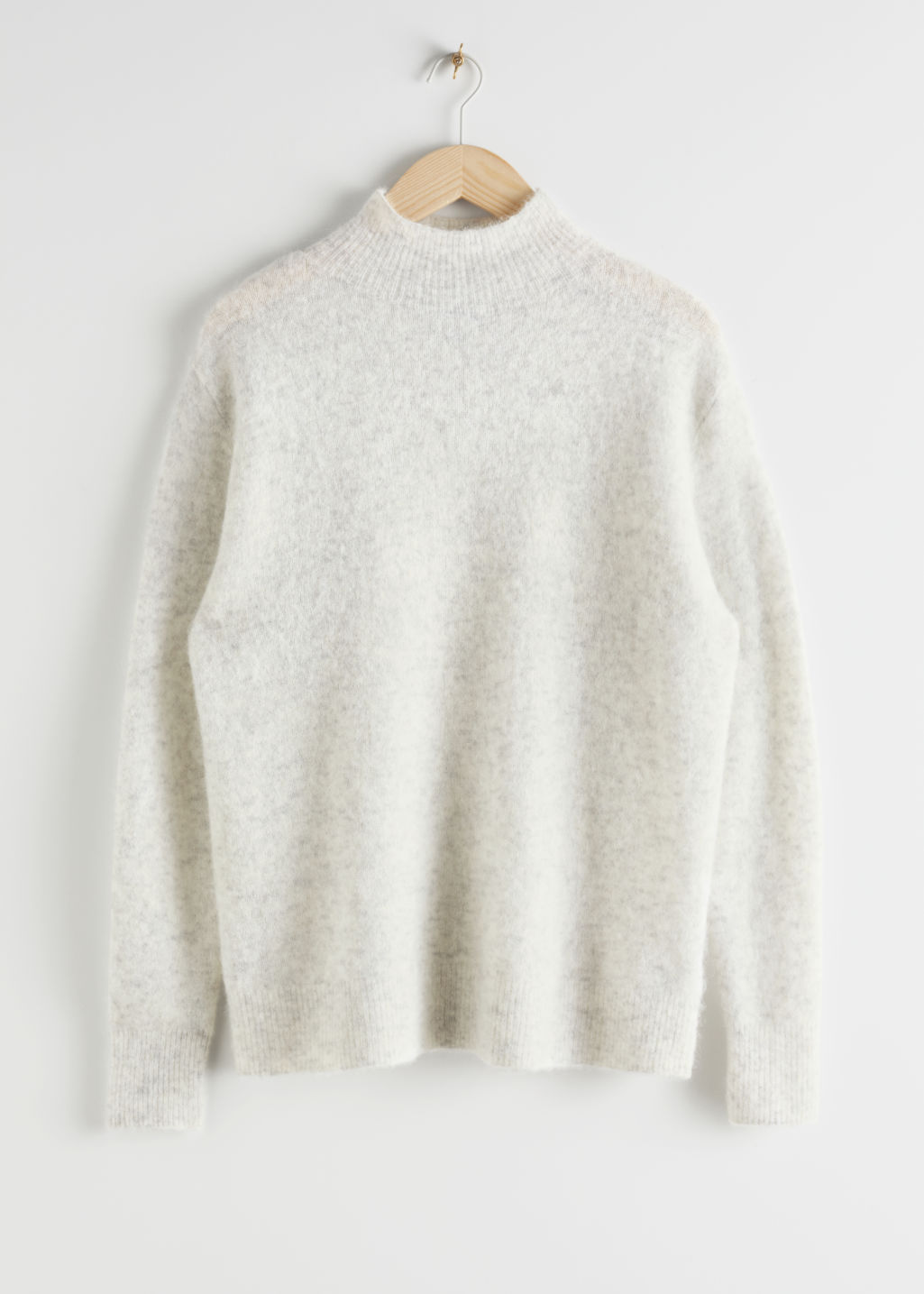 Front image of Stories relaxed mock neck sweater in grey