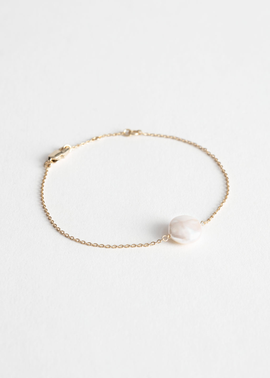 StillLife Front Image of Stories Organic Pearl Pendant Chain Bracelet in White