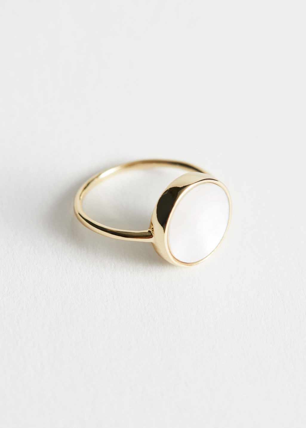 Front image of Stories iridescent shell pendant ring in white
