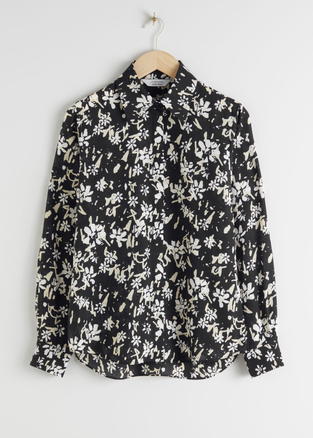 Front image of Stories floral print silk shirt in black