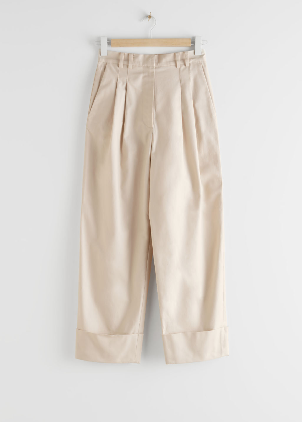 StillLife Front Image of Stories Relaxed High Waisted Cotton Trousers in Beige